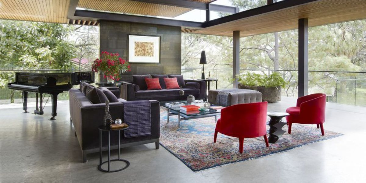 Find a rug that fits the size of the room and it can anchor the furniture.