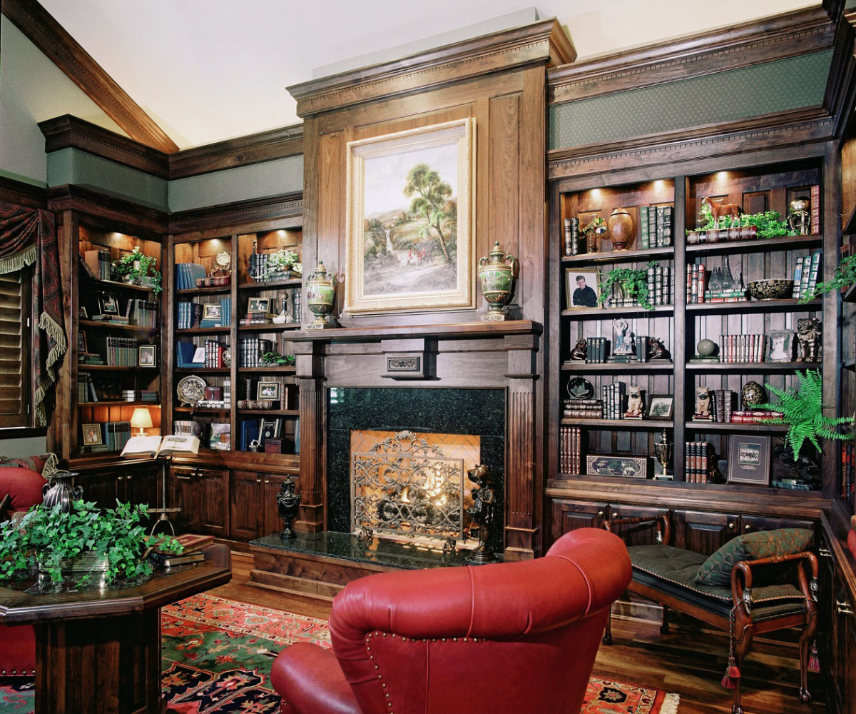 This masculine old world study is full of rich, beautifully carved built-ins.