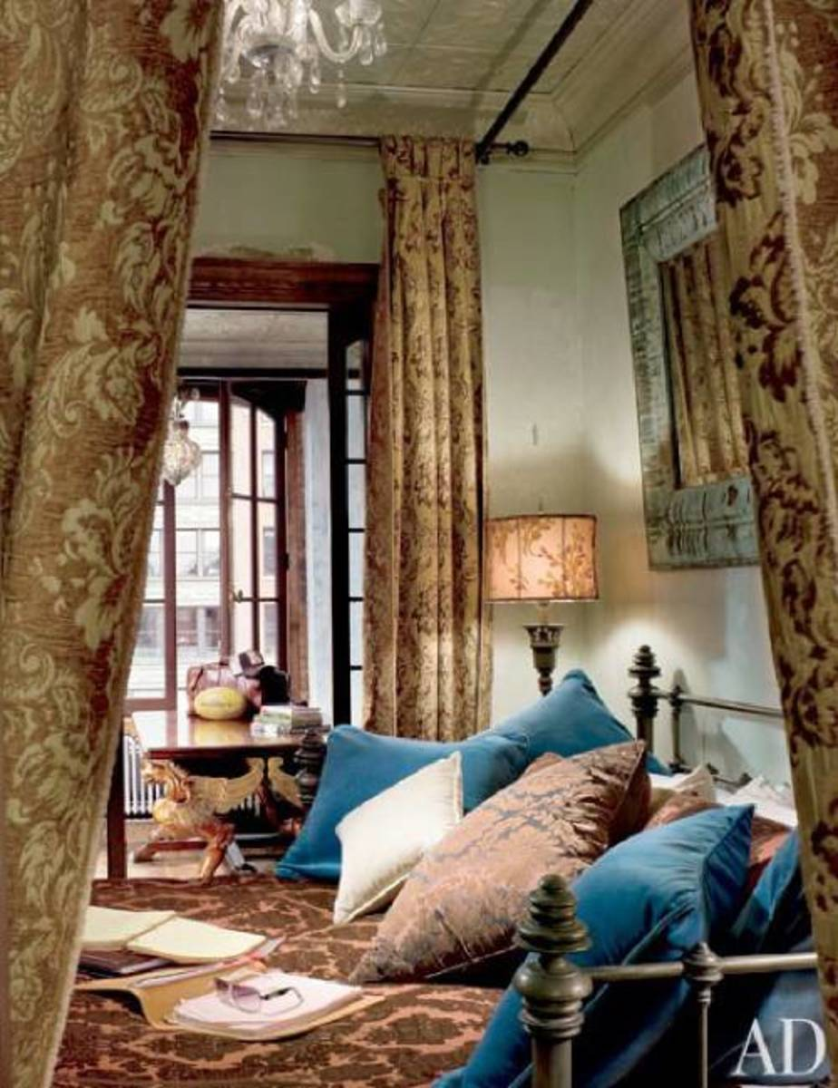 Ornate fabric and curtains add a touch of elegance to the bedroom.