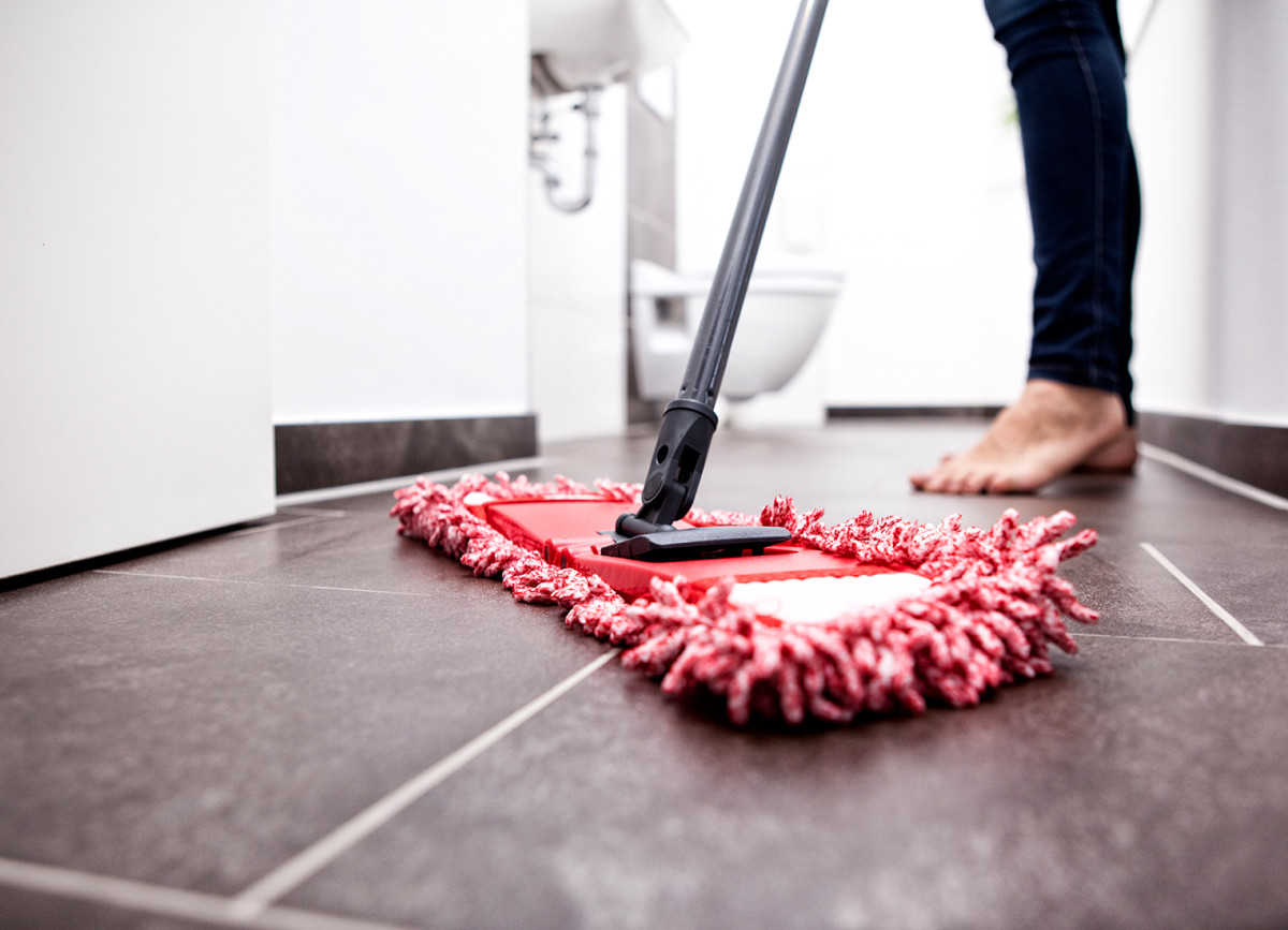 If your tiles have a film of soap residue go over it with a slightly damp microfiber mop to remove the haze.