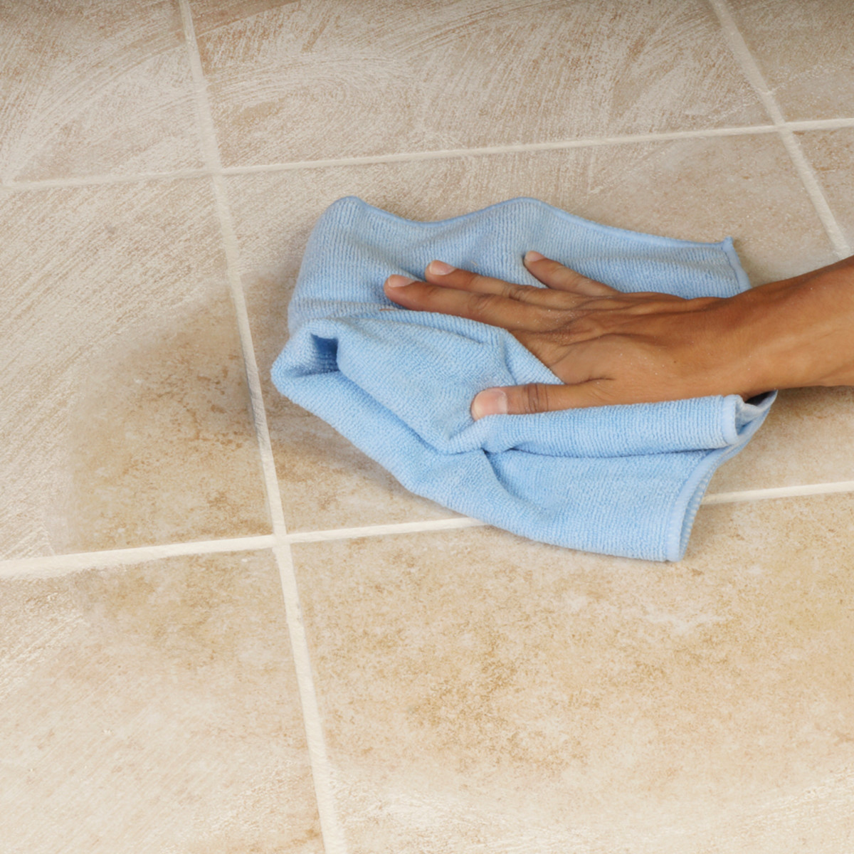Quickly wipe up the tiles to prevent calcium water spotting.