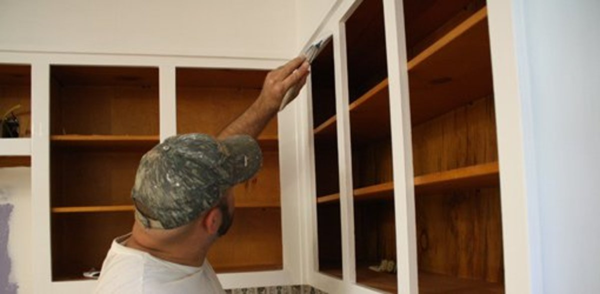 You can do it by hand or rent a sprayer to paint your kitchen cabinets.