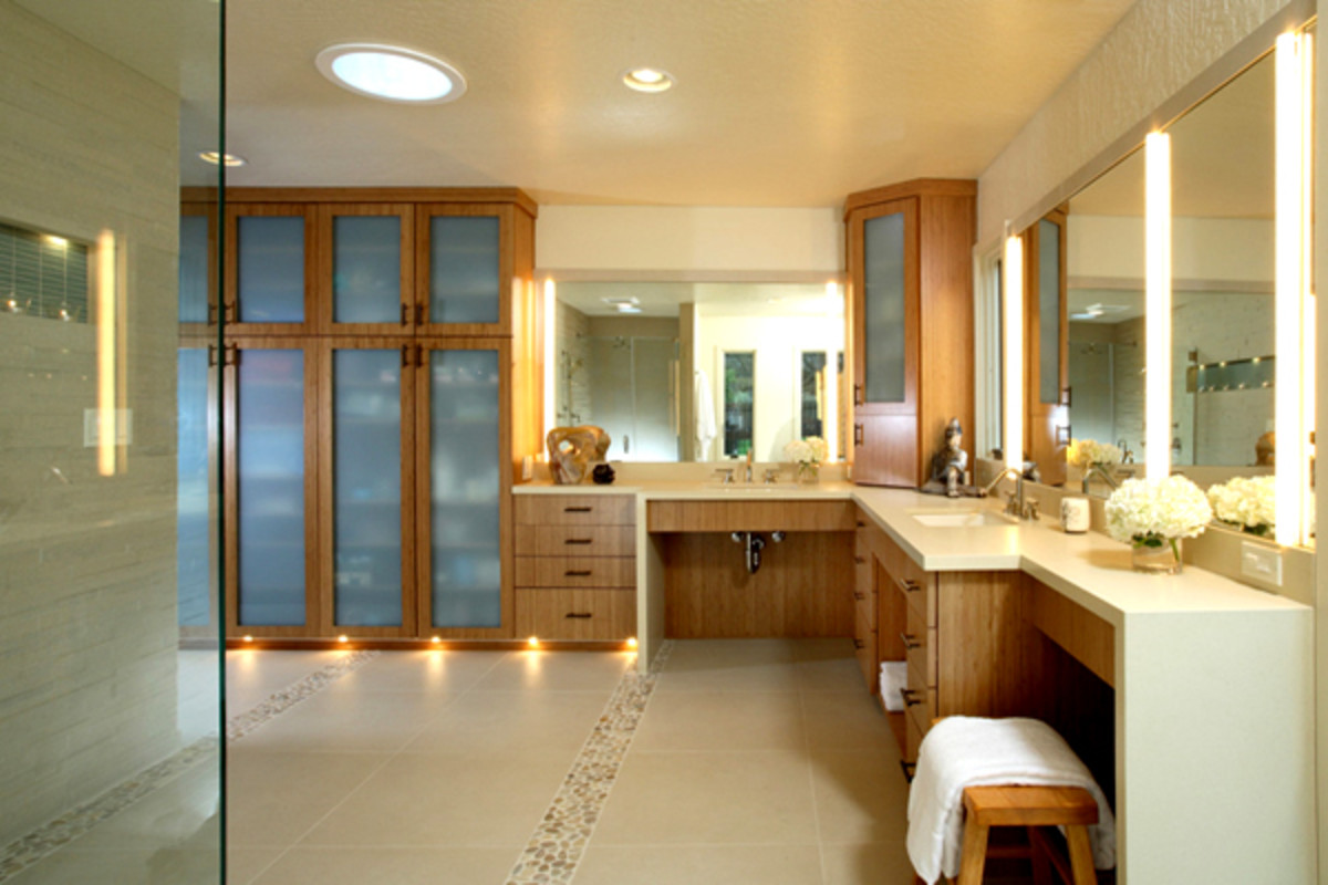 This bathroom has an excess of recessed cans, vanity light bars and ceiling fixtures. Vanity sconces in addition to overhead lights give the space uniform illumination.