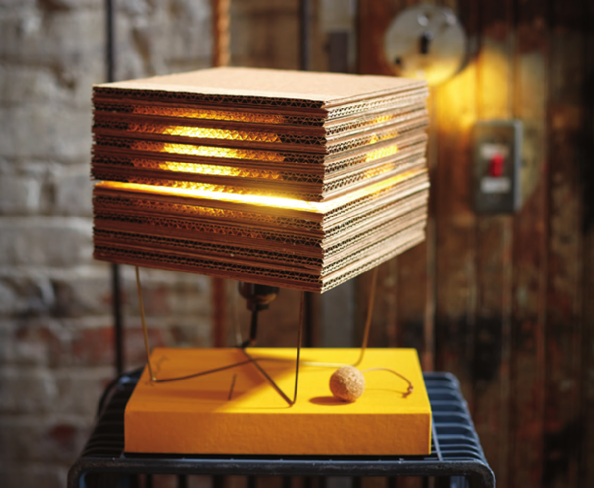 You can make your own DIY cube lamp out of corrugated cardboard, a wire coat hanger, and a few additional parts, and this article will show you how.