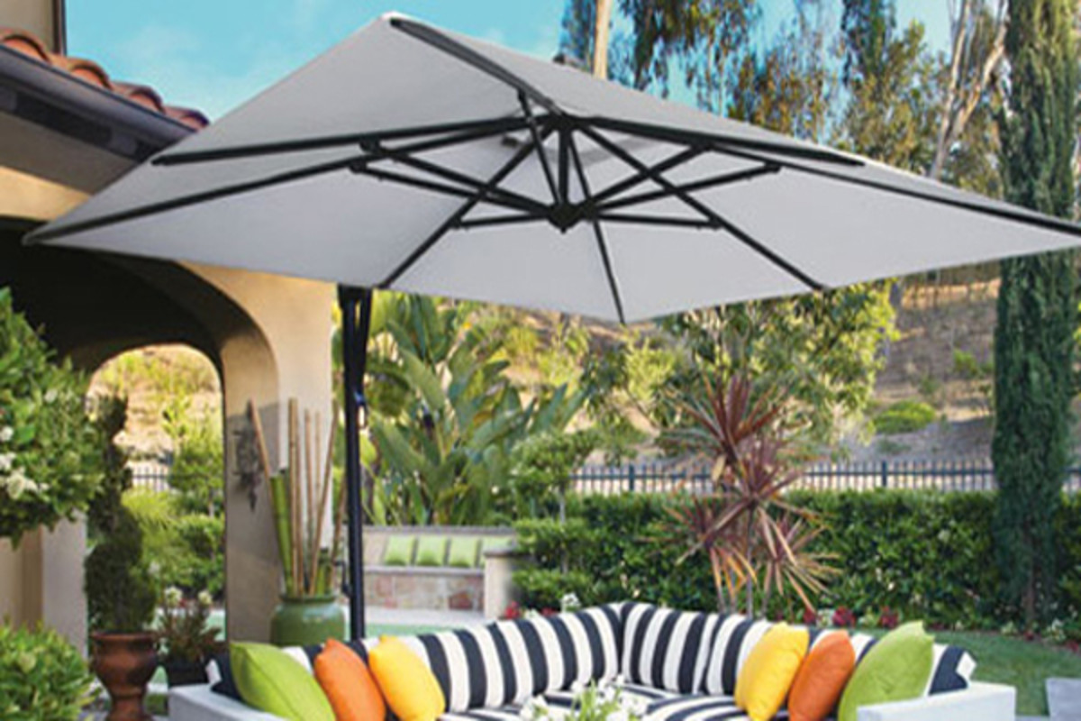 An offset cantilever umbrella base is positioned on the side rather than in the middle of a seating area.