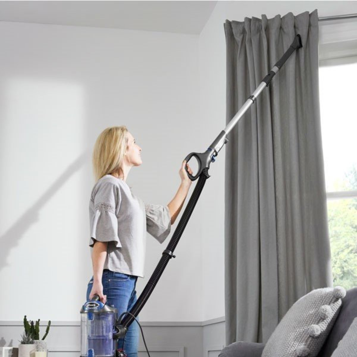It's best to vacuum your curtains to remove the dust that has accumulated over the winter.