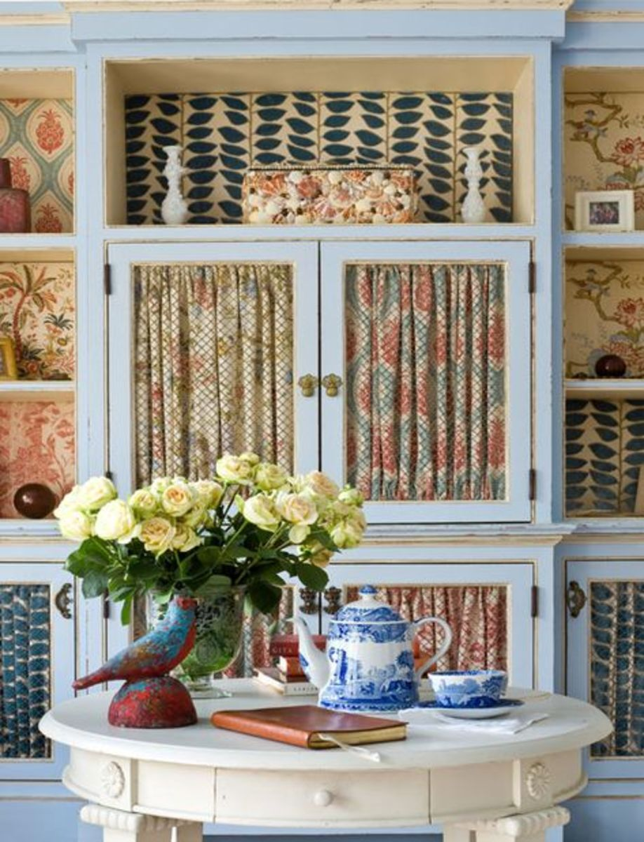 Gathered fabric inside the cabinet gives the kitchen a soft appearance.