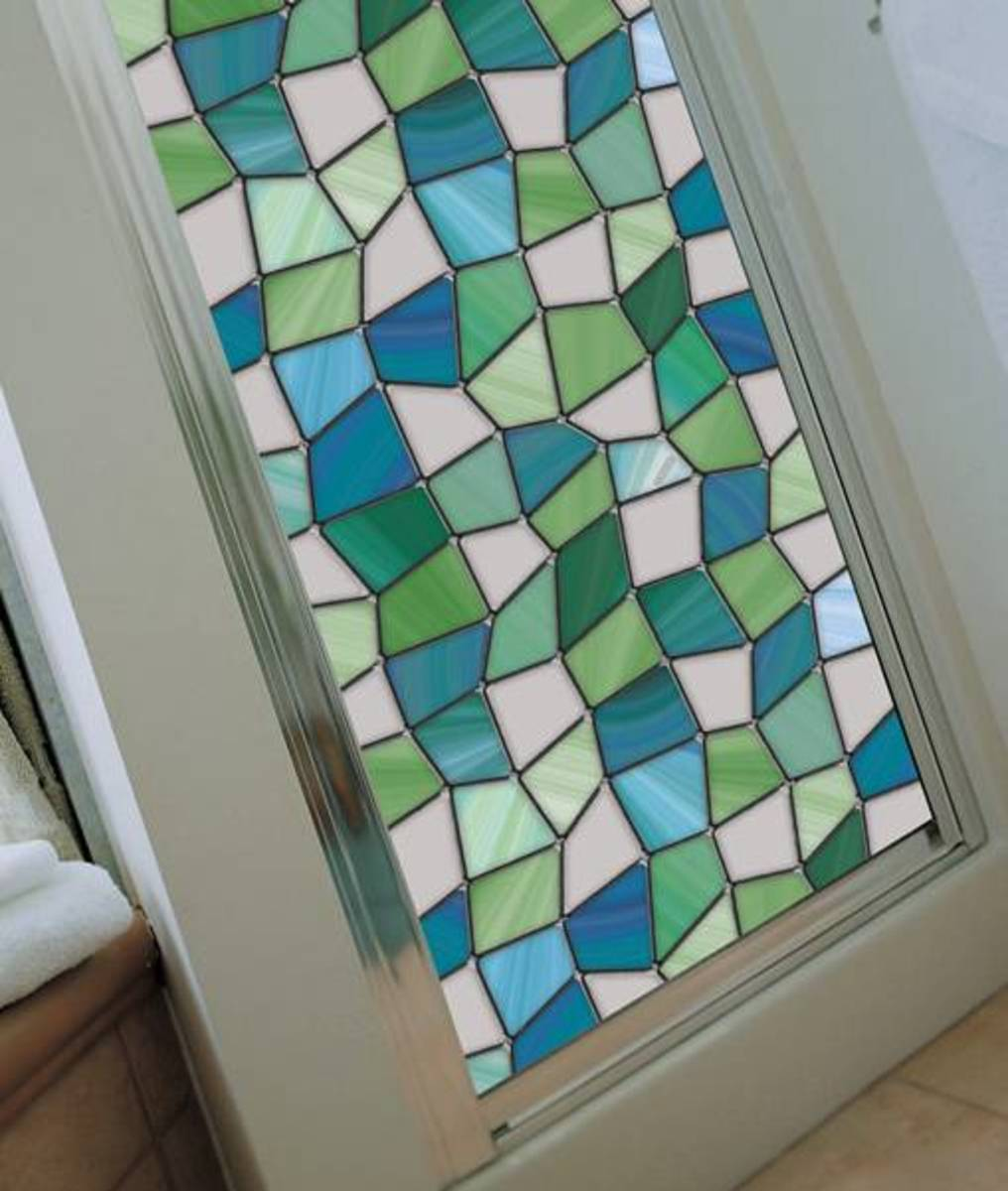 Stained glass paint kits or decorative window film is a great way to spiff up your kitchen cabinets.