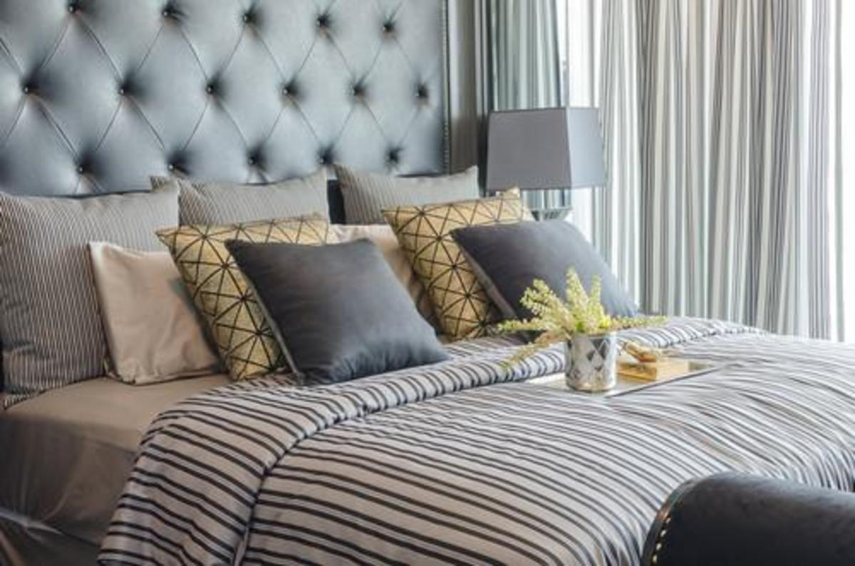 Lots of pillows make you bed look just like an elegant hotel room.