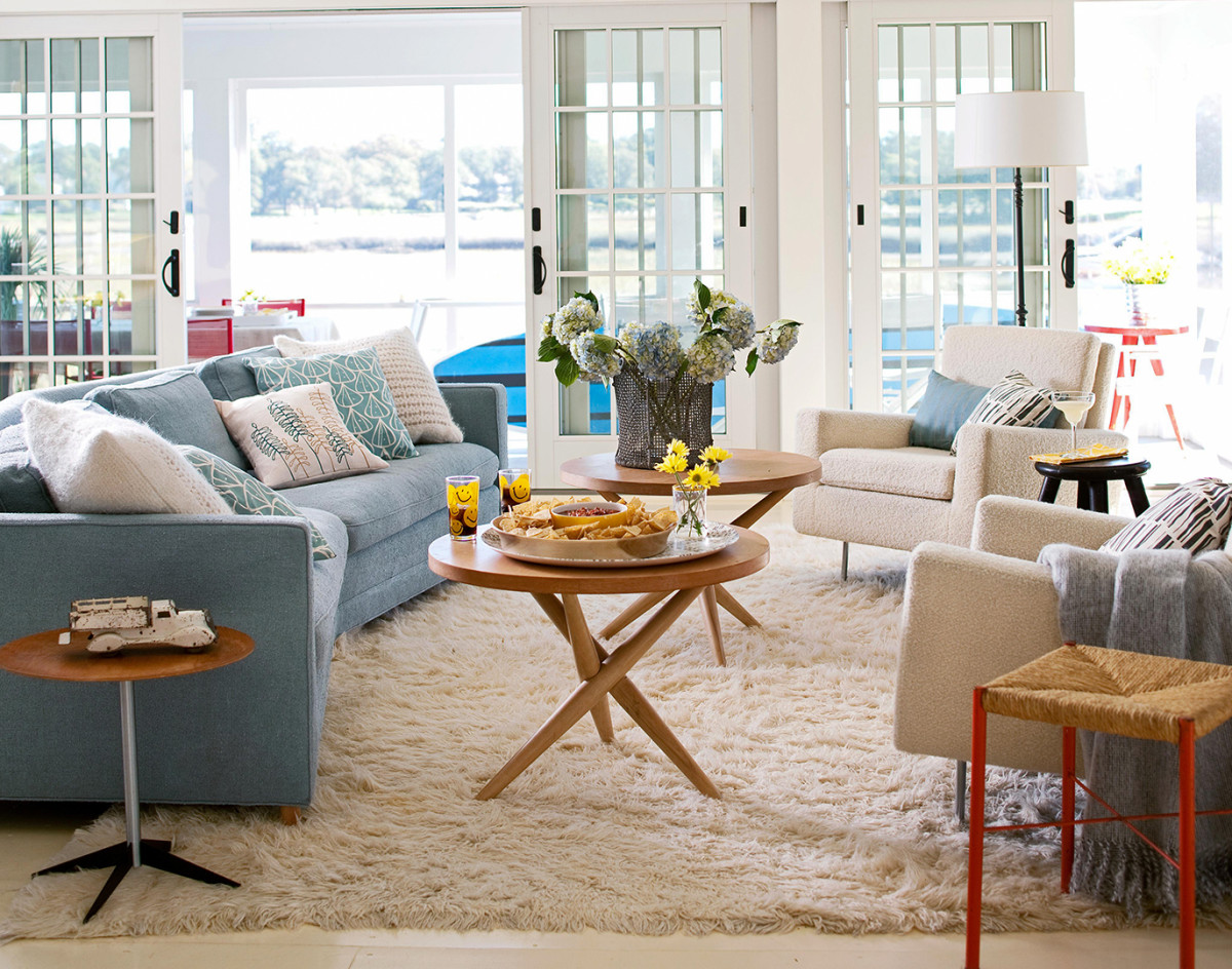 Use minimal furniture pieces to keep your rooms open and breezy.