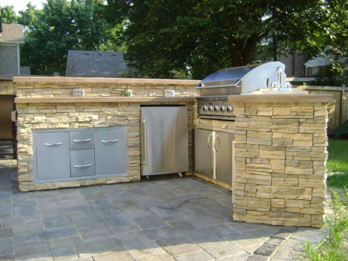 Pavers or stone give an outdoor kitchen a rustic appearance.