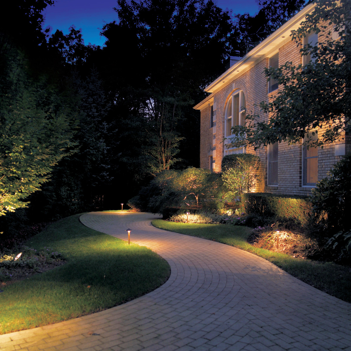 Lighting fixtures look nice during the day and create a beautiful landscape emphasis at night.