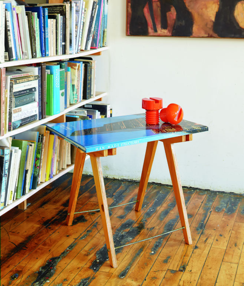 This guide will show you how to build your own DIY coffee table out of a large book just like this one.