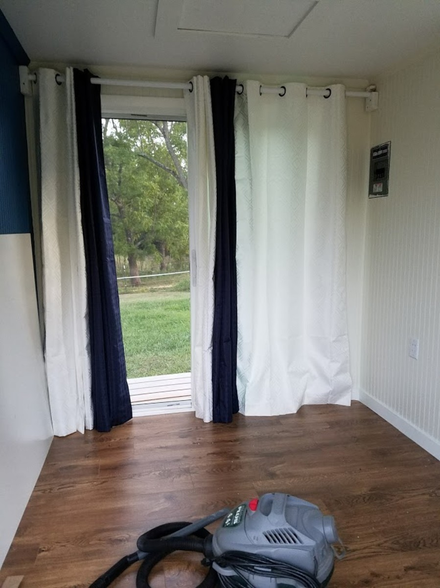 Curtains hung and white board ready for installation.