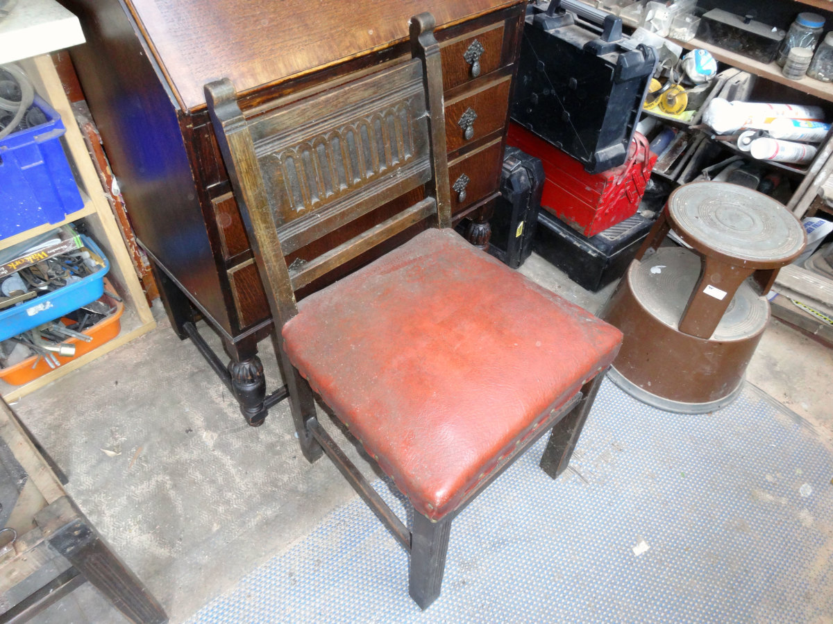 One of the four chairs waiting to be renovated.