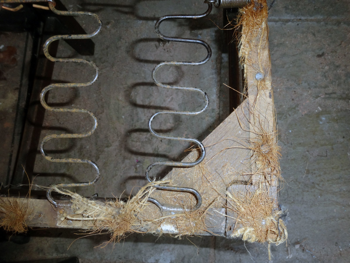 Tuffs of horsehair removed as the chair is de-nailed.