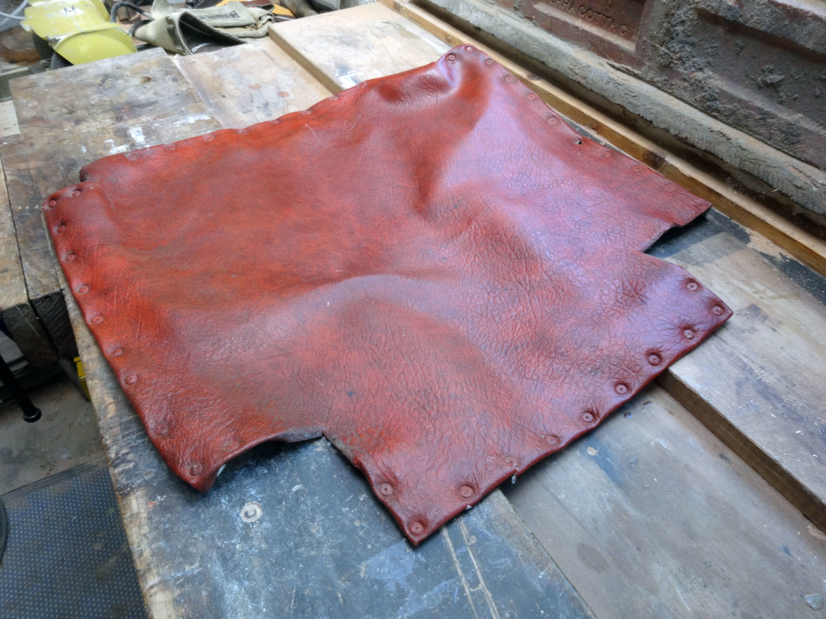 Salvaging the leather seat covers for reuse when the seats are reupholstered.