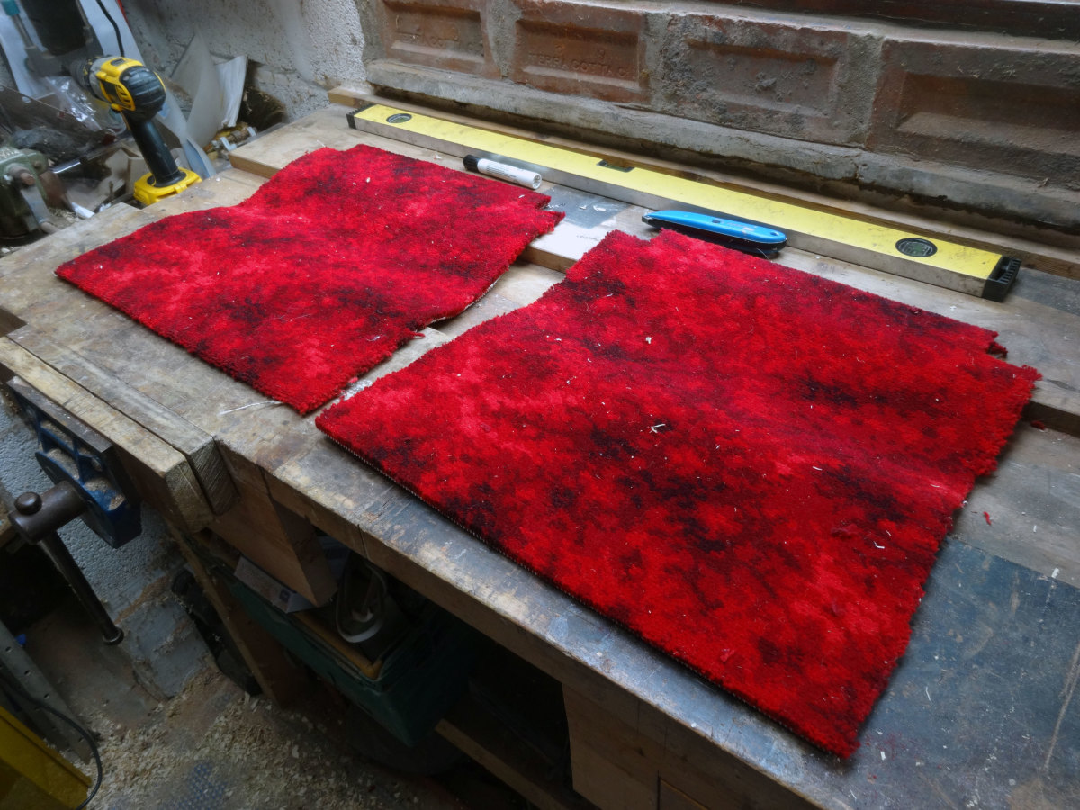 Cutting squares to fit from off cuts of an Axminster carpet used in one our bedrooms.