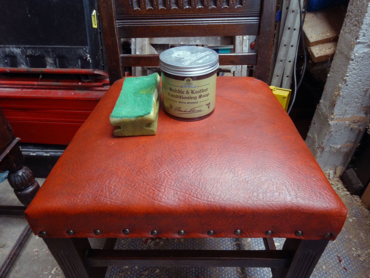 Applying the Saddle & Leather Conditioning Soap to clean the leather