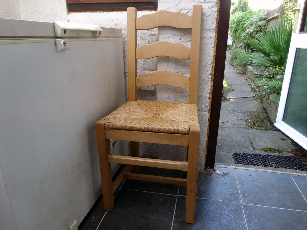 Raffia chair my wife had used for sewing, but now moved to her food storage shed, replacing a modern dining chair which has no value and is to be burnt.