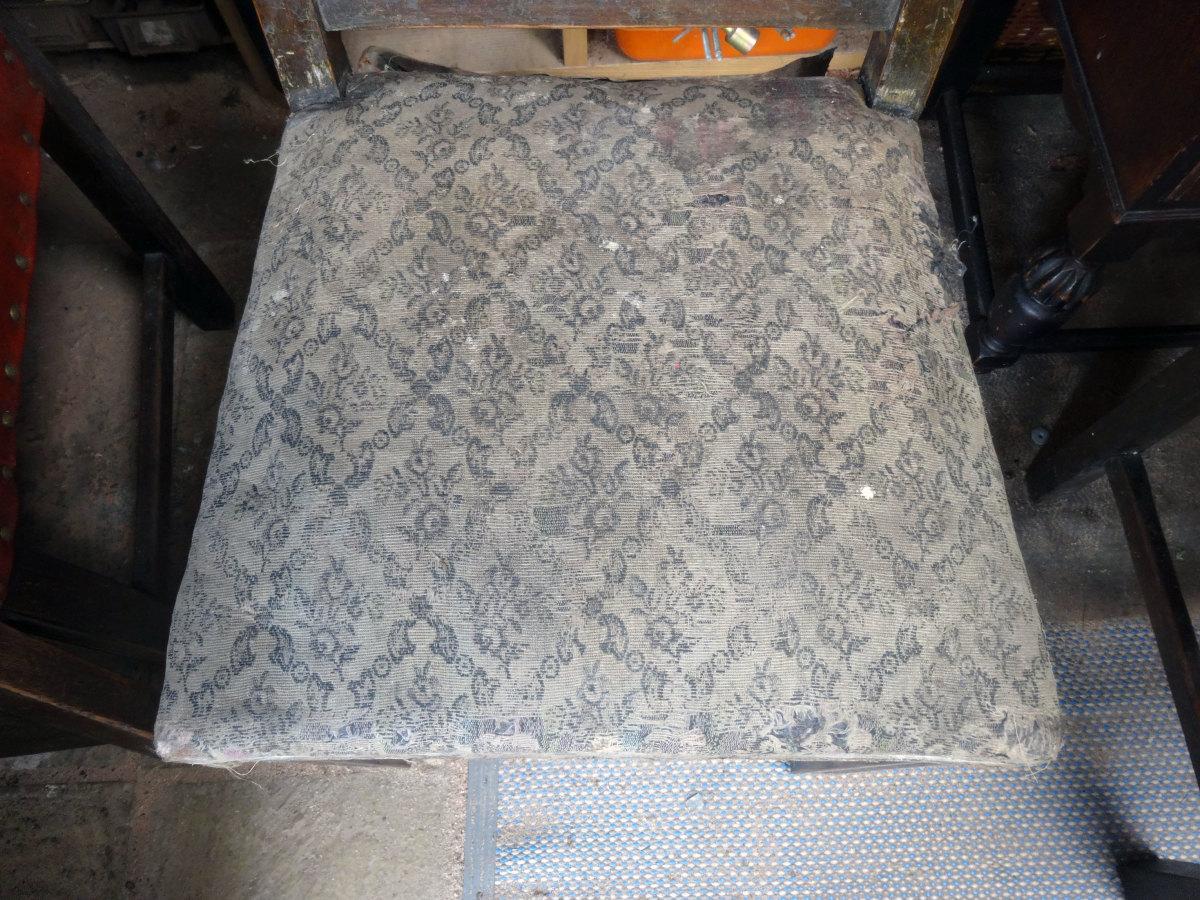 The original seat covering.