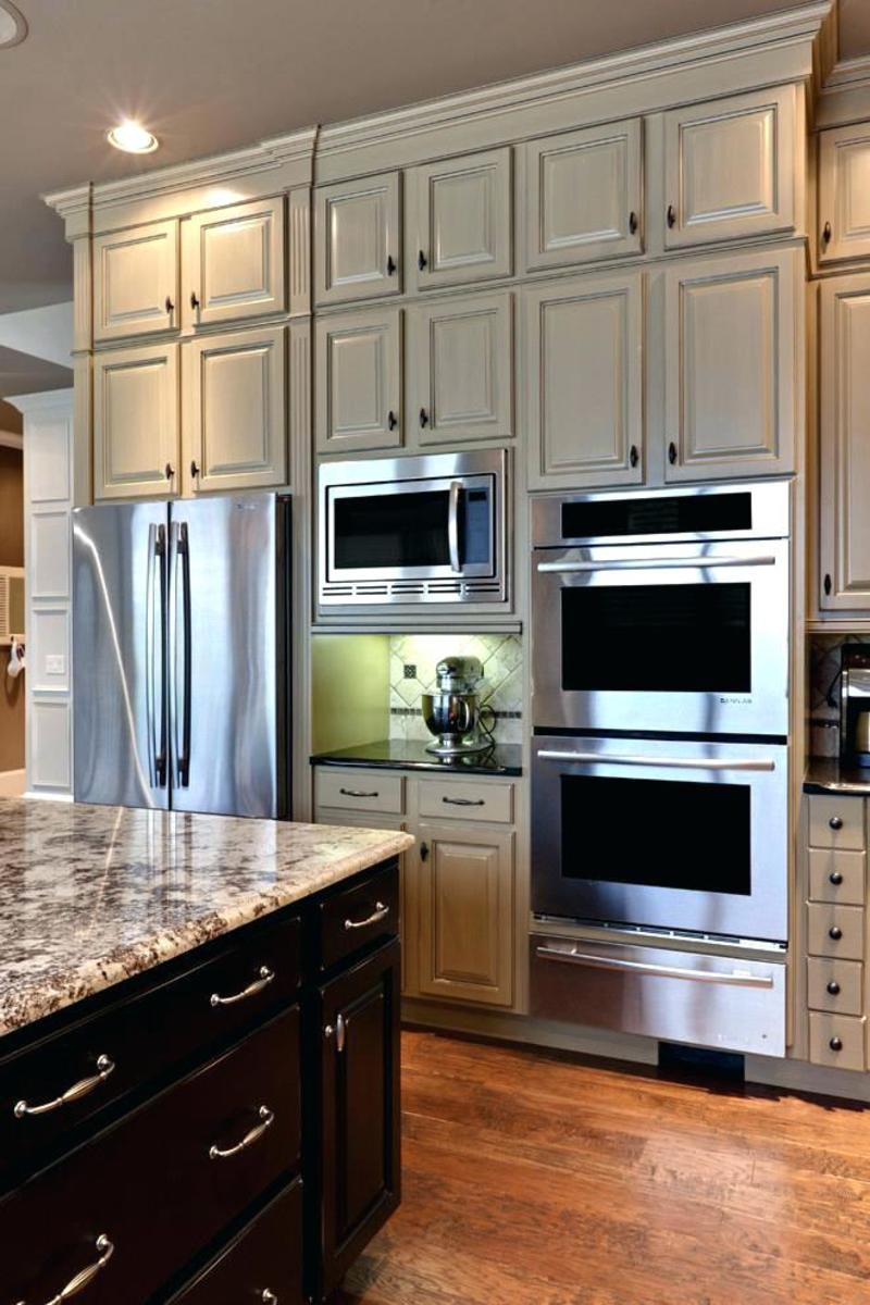 Floor-to-ceiling storage keeps the kitchen organized.