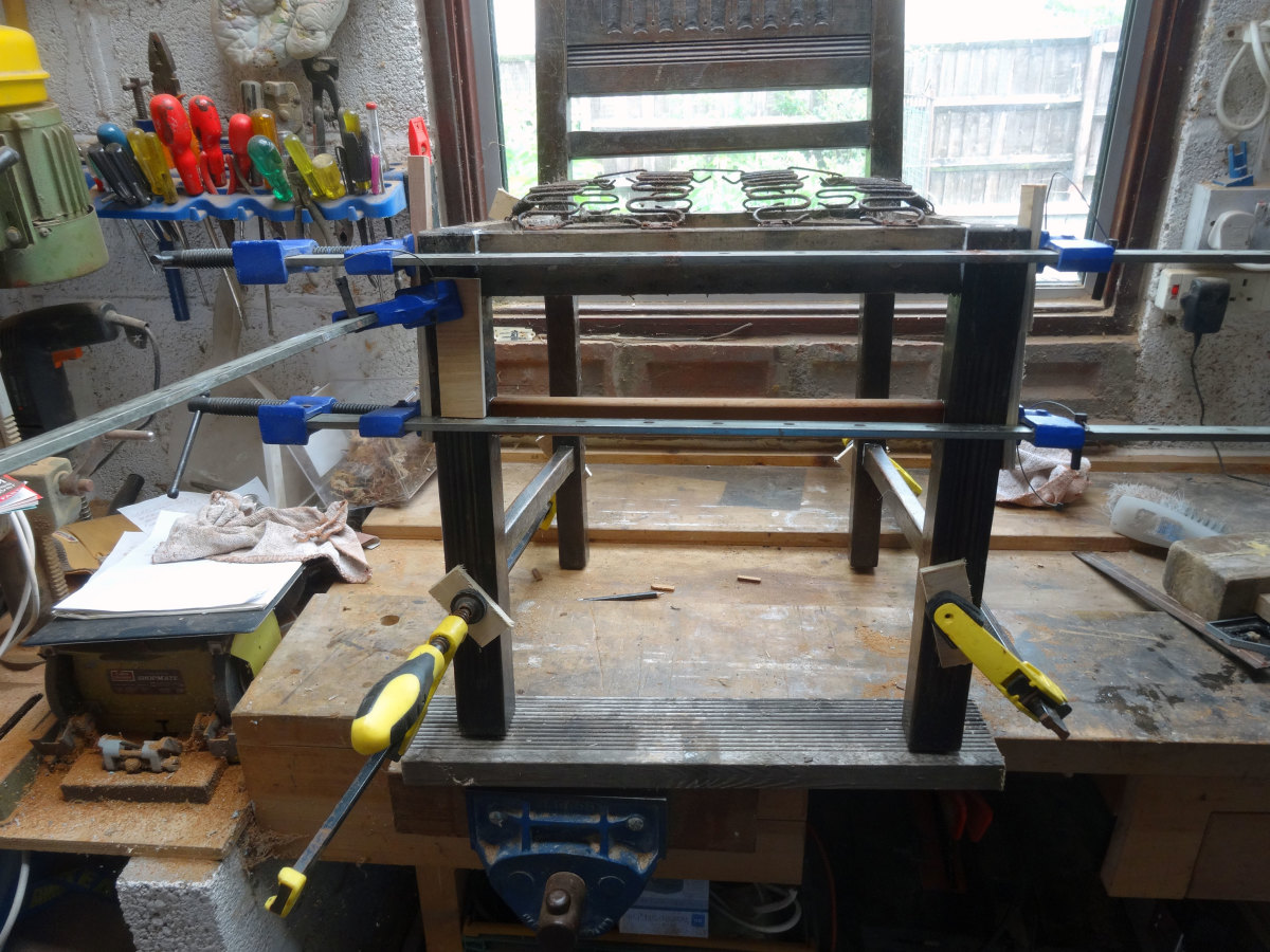 Chair legs glued and clamped.
