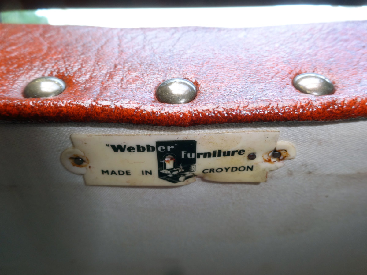 Manufacturer's label reaffixed to the underside of the chair's seat.