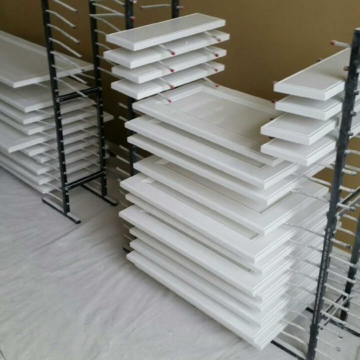 Freshly painted cabinet doors on my drying racks. The special design allows both sides to be painted at one time.