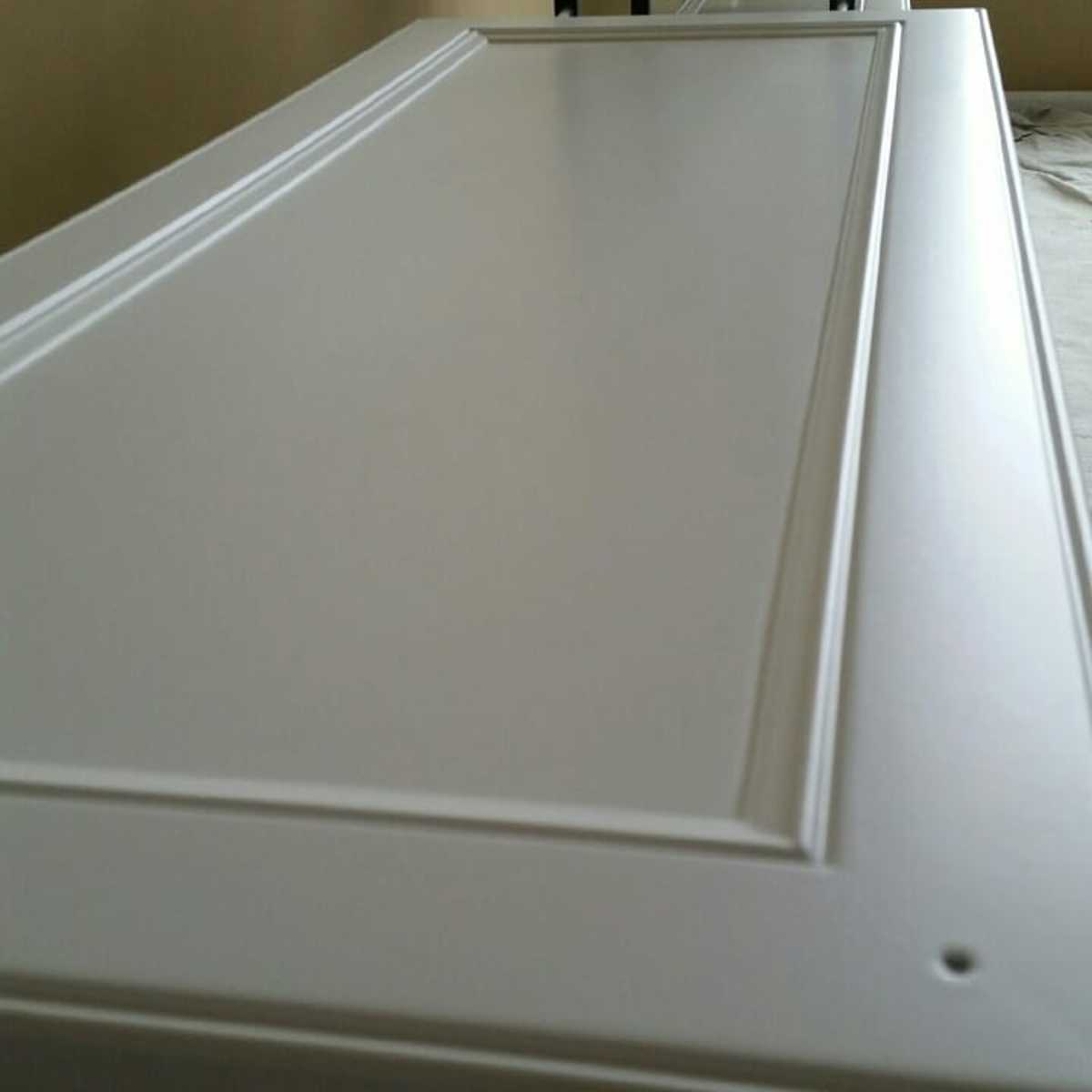 Spraying Cabinet Doors Vertically vs Laying Flat: Which One's Better?