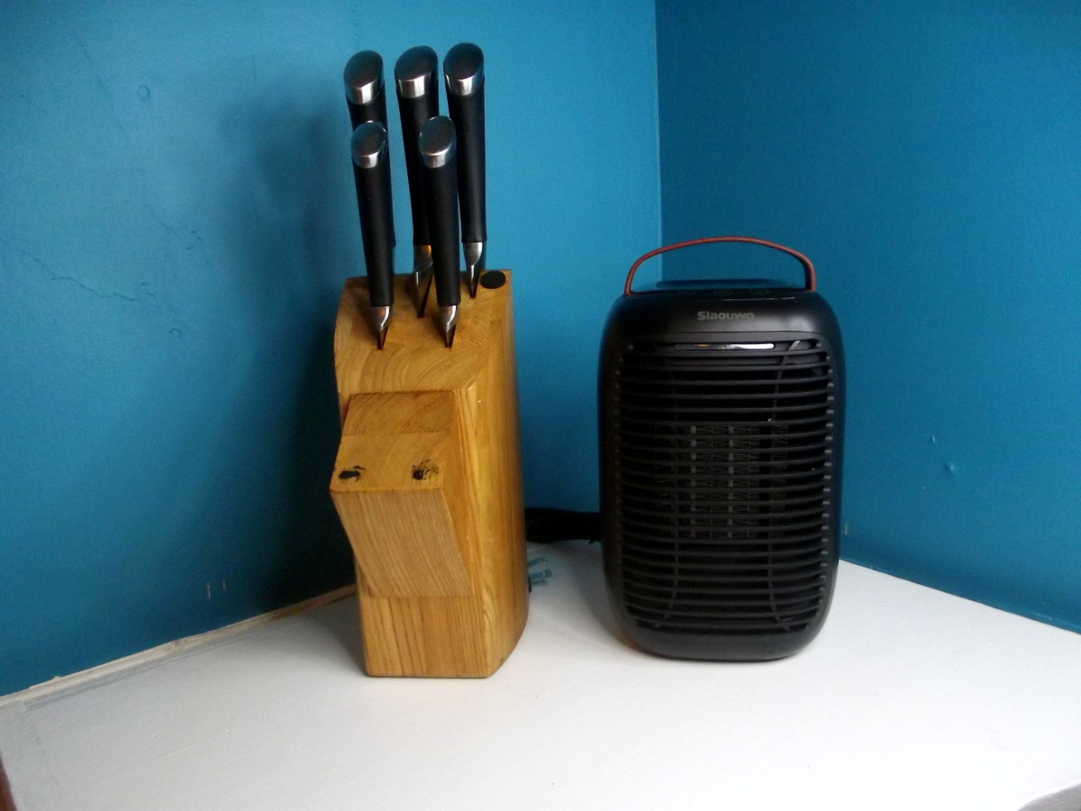 Slaouwo Space Heater pictured alongside a knife block.