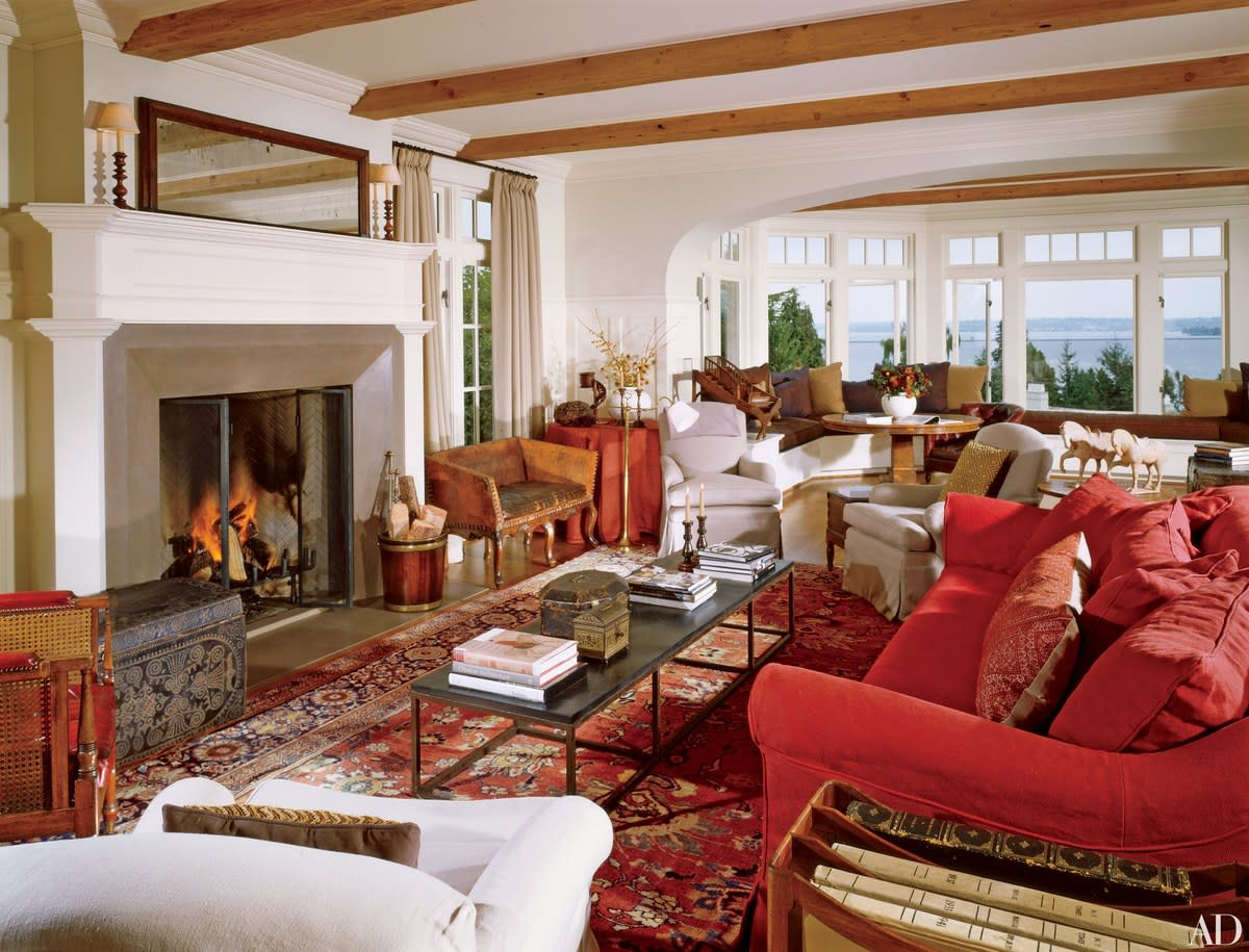 Bring in an antique rug to brighten up and warm the room.