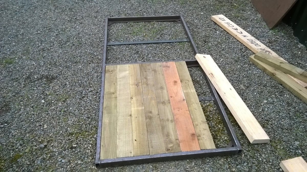 "Door constructed from 2 x1 steel box and scrap 2"" timber leftovers."
