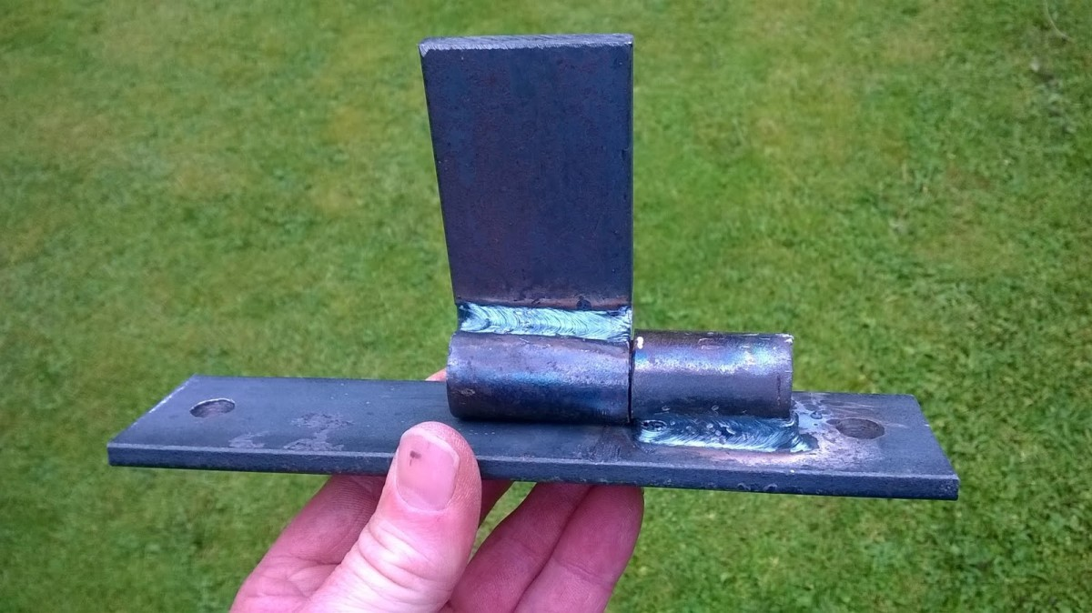 Hinges made from scrap iron bar and round tube.