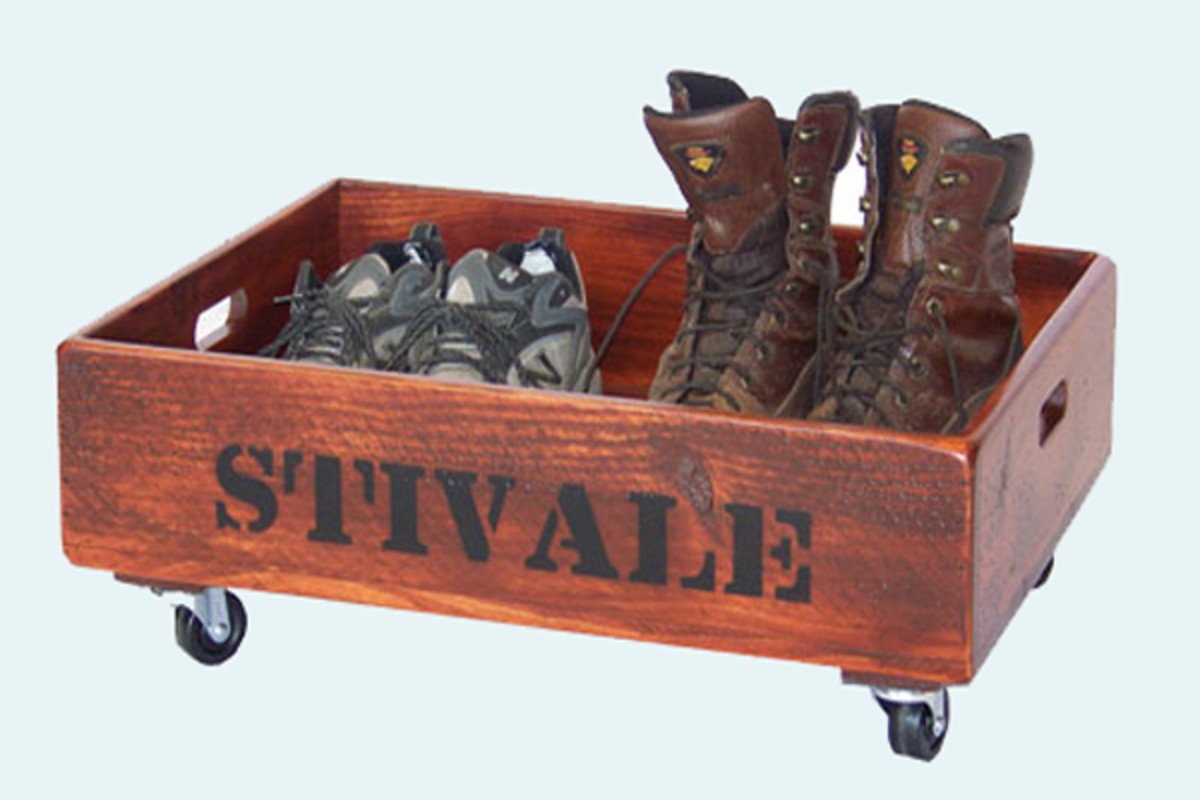 A vintage soda crate is perfect for a shoe holder in the mudroom that can roll under the bench.