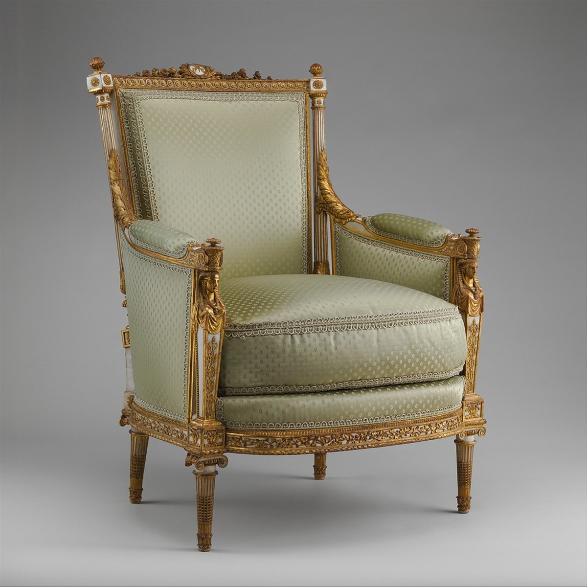 This French bergère, circa 1788, is carved from walnut and upholstered in embroidered silk.