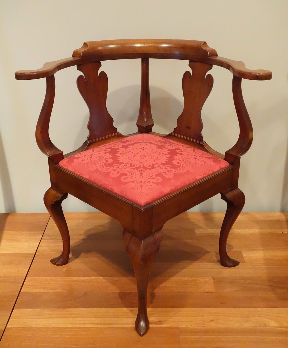 This antique corner chair is made of cherry and poplar, circa 1750.