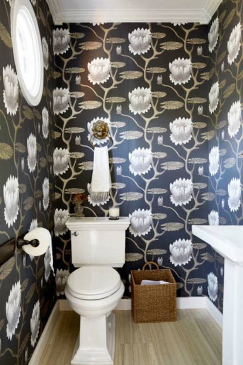 Whimsical wallpaper creates a fabulous powder room.