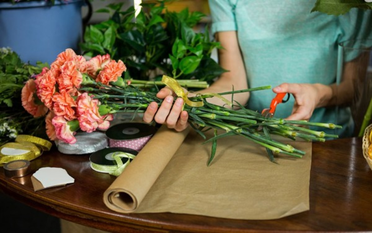 Cut the stems with a sharp knife or floral sheers at 45° angles.