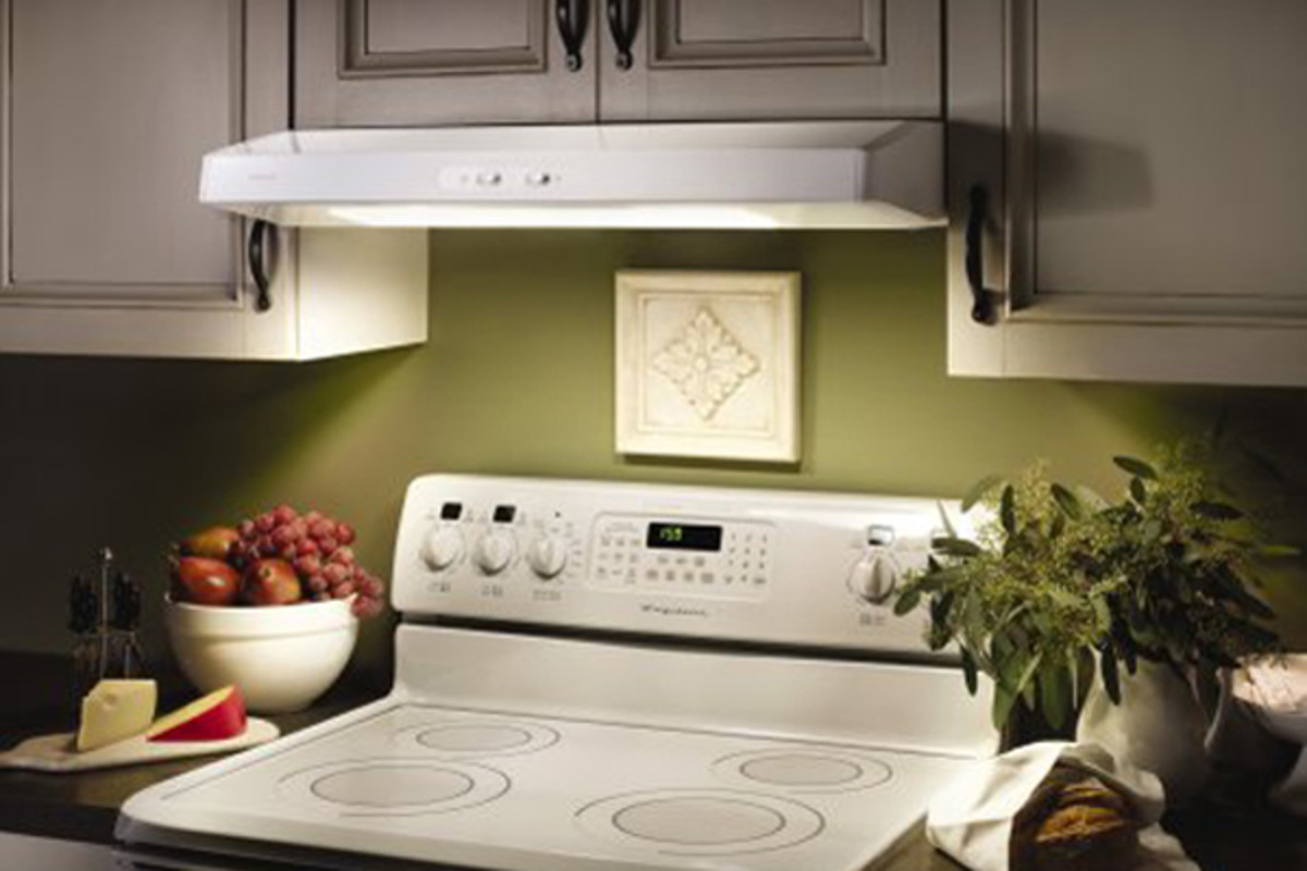 A small cost-effective stove hood is great for a small kitchen.