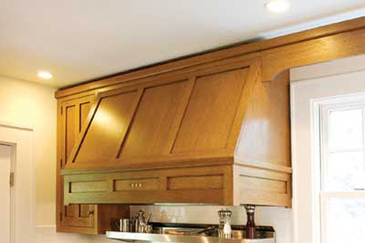 A wood-paneled range hood is ideal for a craftsman kitchen.