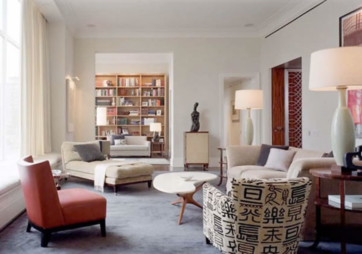 A large and open living room space with three different seating zones.
