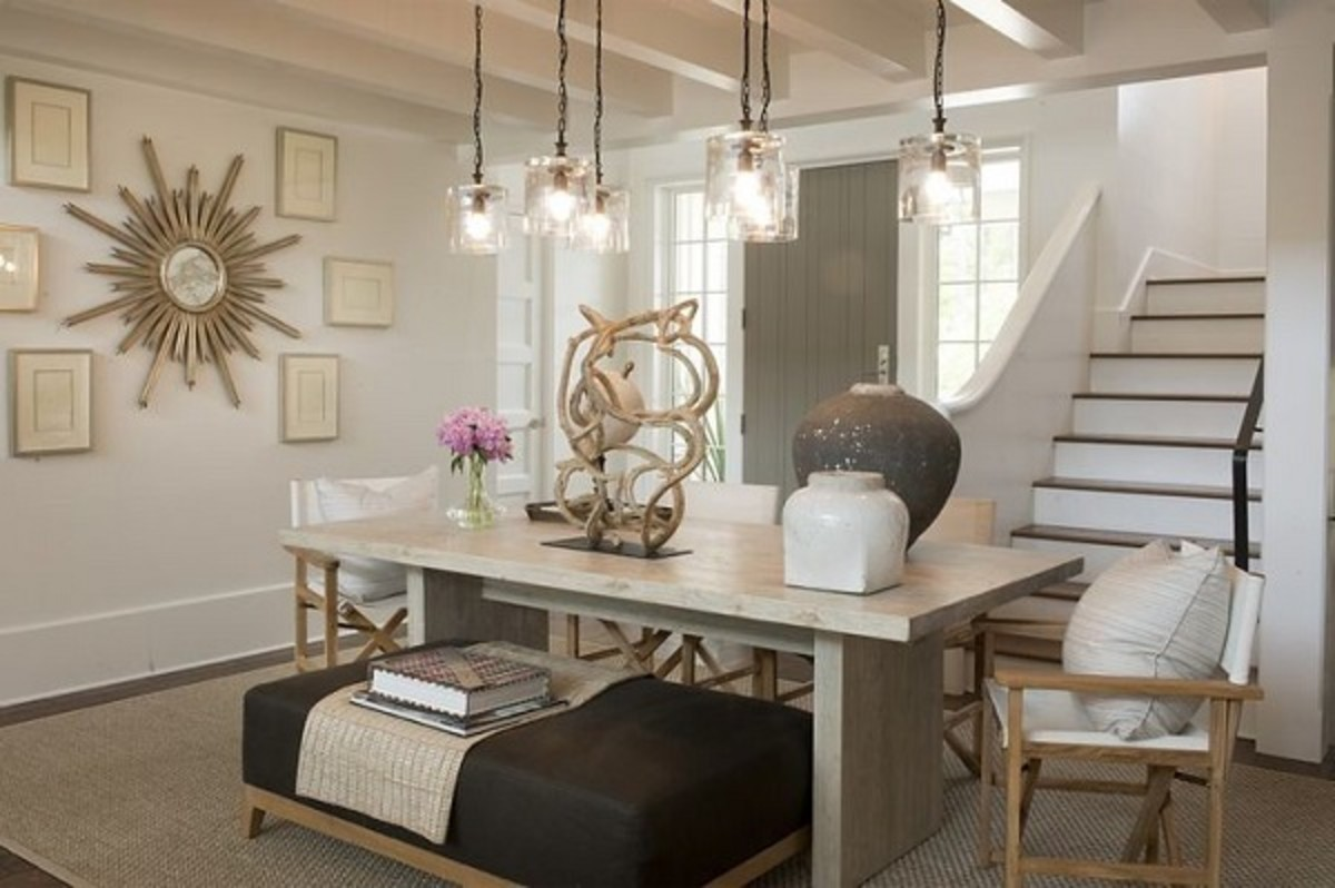 Key decor items in this room are framed art, wall clock, pendant lights, and the tabletop decorations. A great way to accessorize an interior space. Notice how they make the room look elegant and professionally put-together.