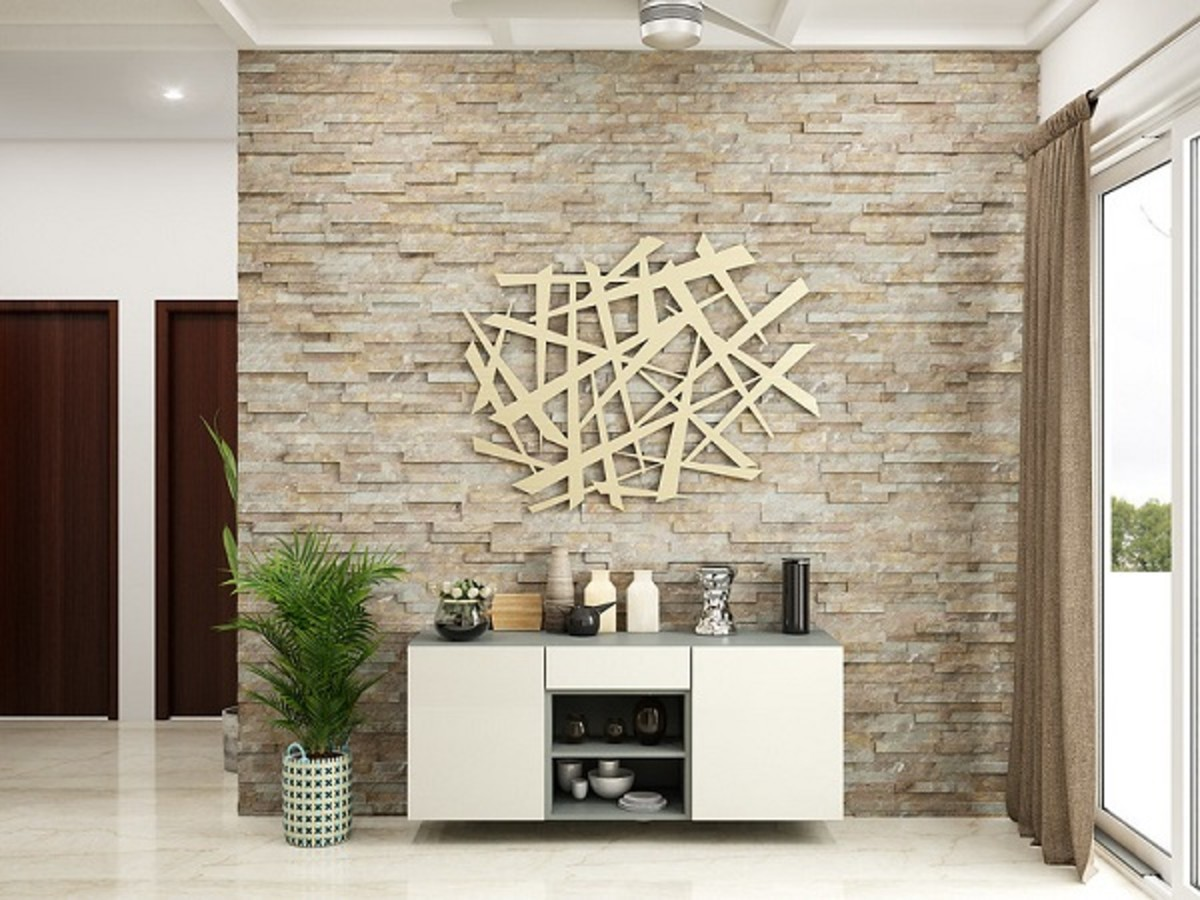 A unique feature wall with faux stone application and an elaborate metal wall art.
