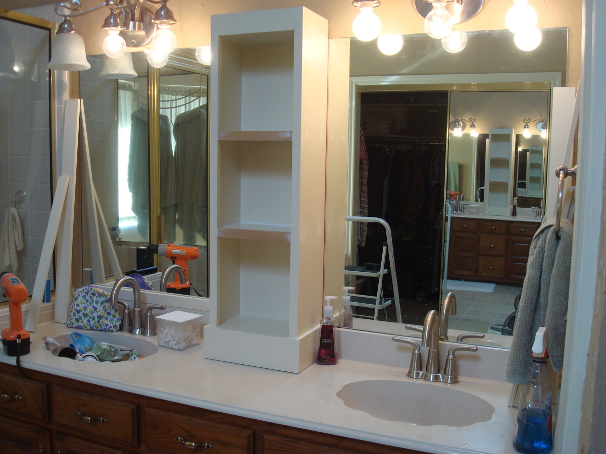 Notice here that the lighting fixtures are still in progress, the mirror edges are still unframed, and the crown molding is not yet installed.