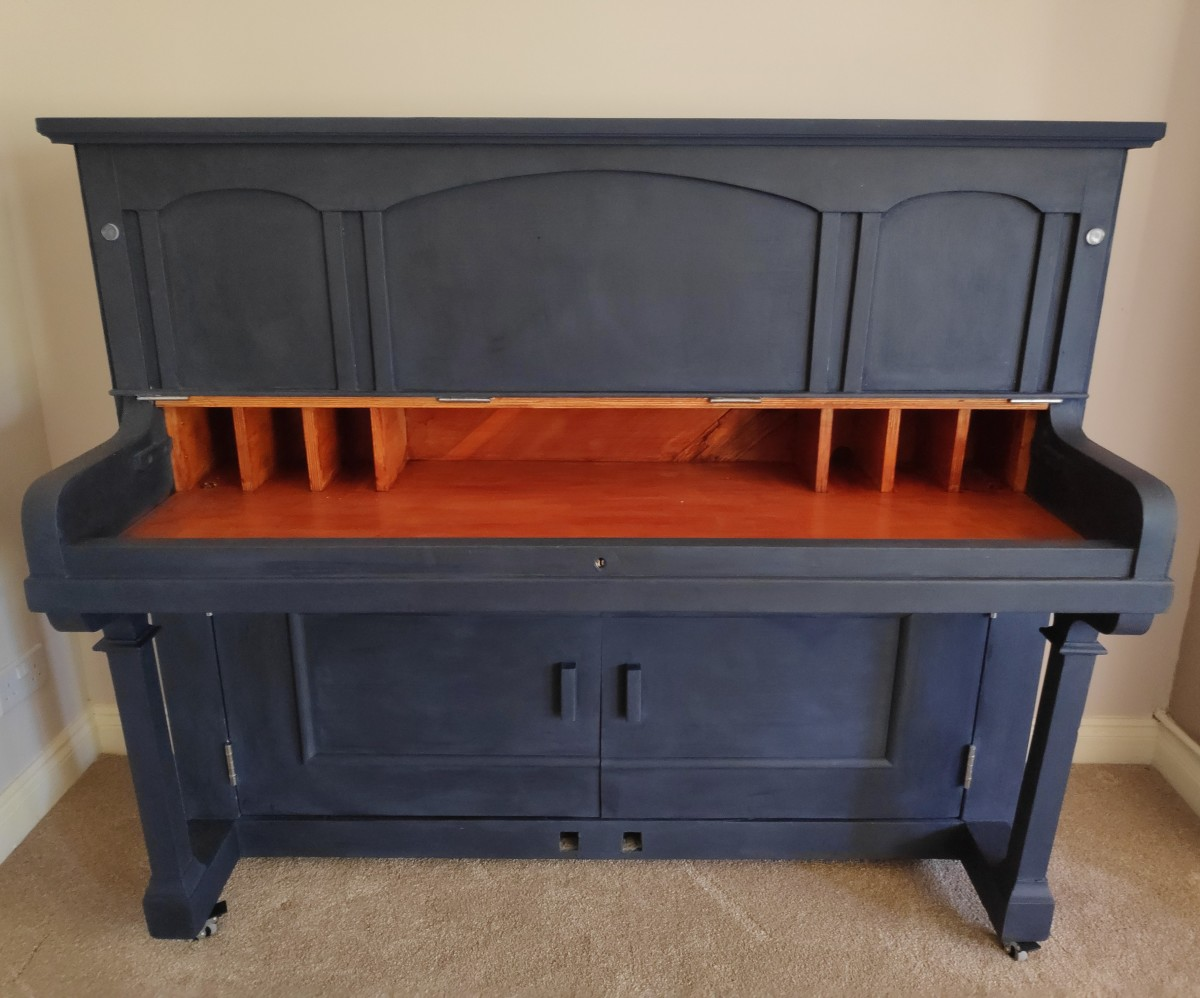 Our finished piano drinks cabinet, ready to be stocked up with delicious beverages.