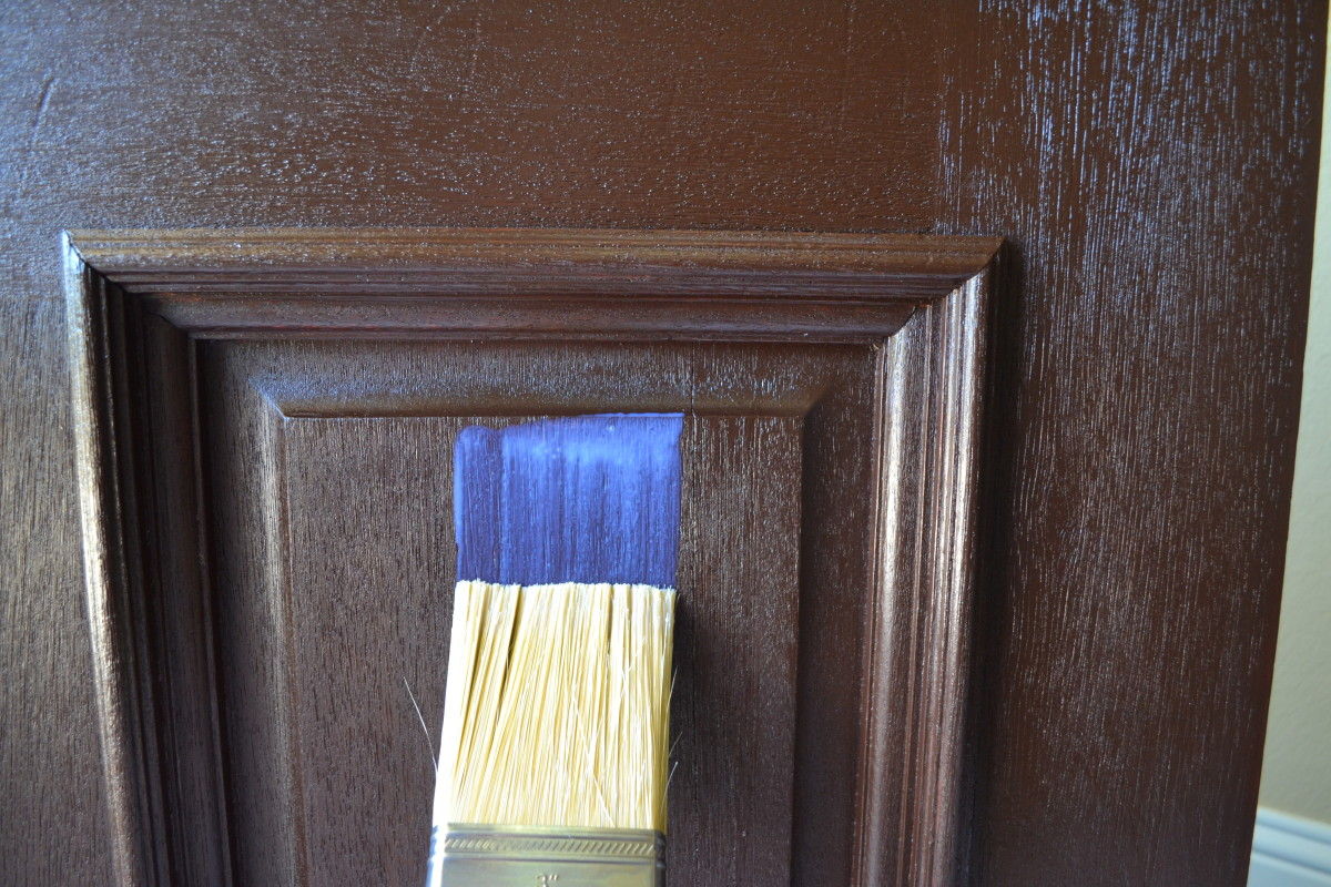 Use a quality painter's brush to apply the topcoat, rather than the foam brush and rags used for applying the gel stain. The top coat looks milky in the can and as it is applied, or strangely blue as in this photo. However, it dries clear.