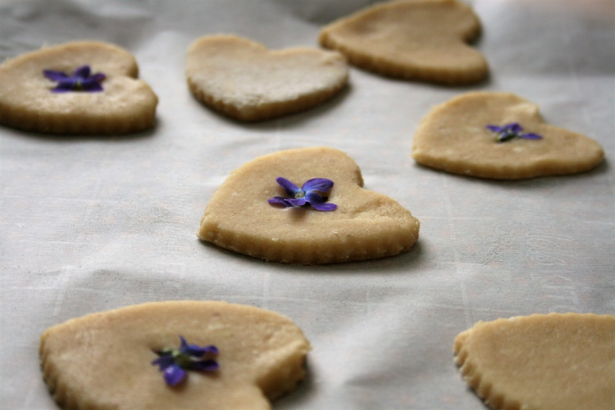 Press violet flowers into cookies before baking.