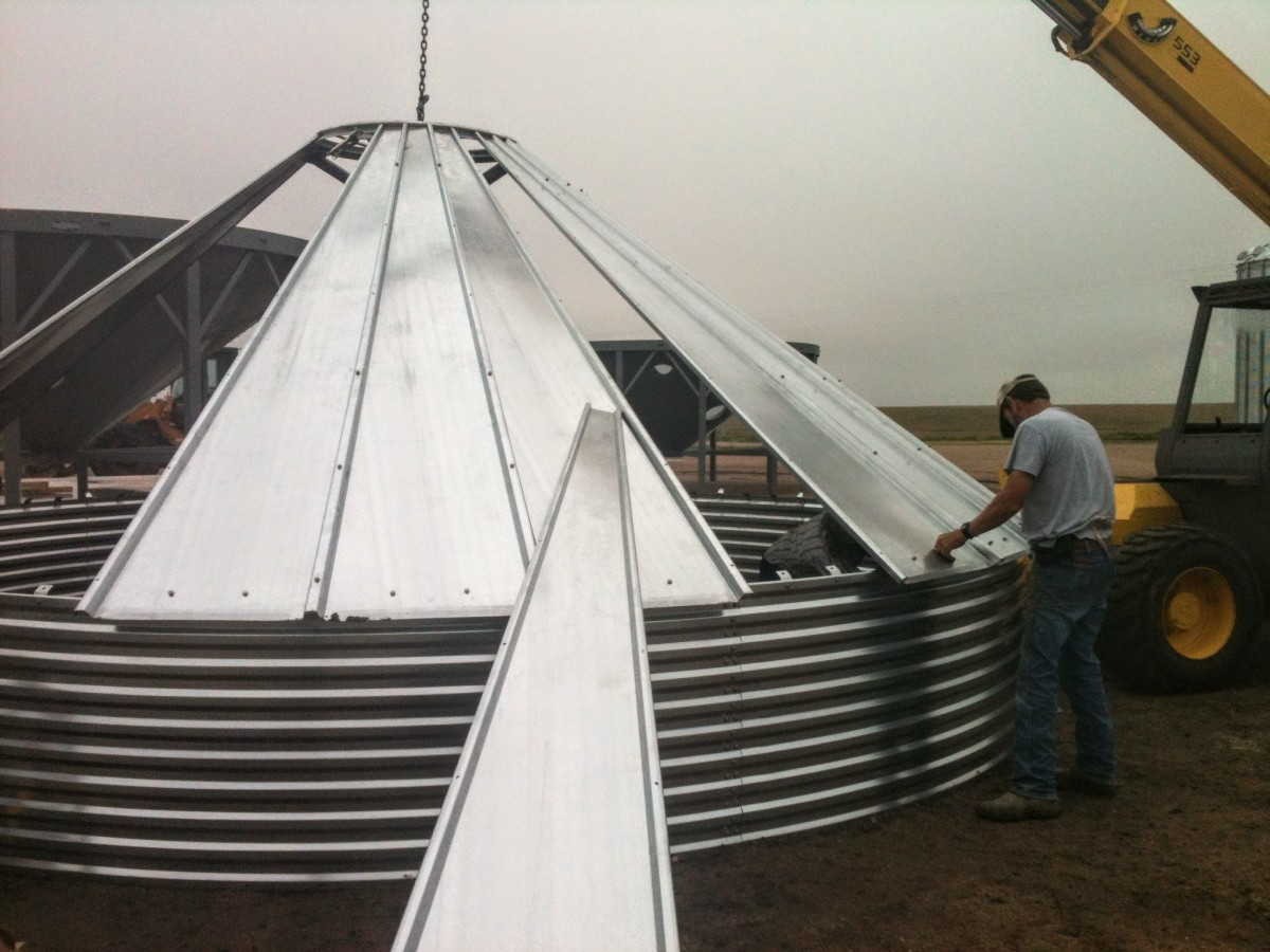The roof panels overlap and bolt together, while a collar and other pieces stabilize and strengthen the conical form.