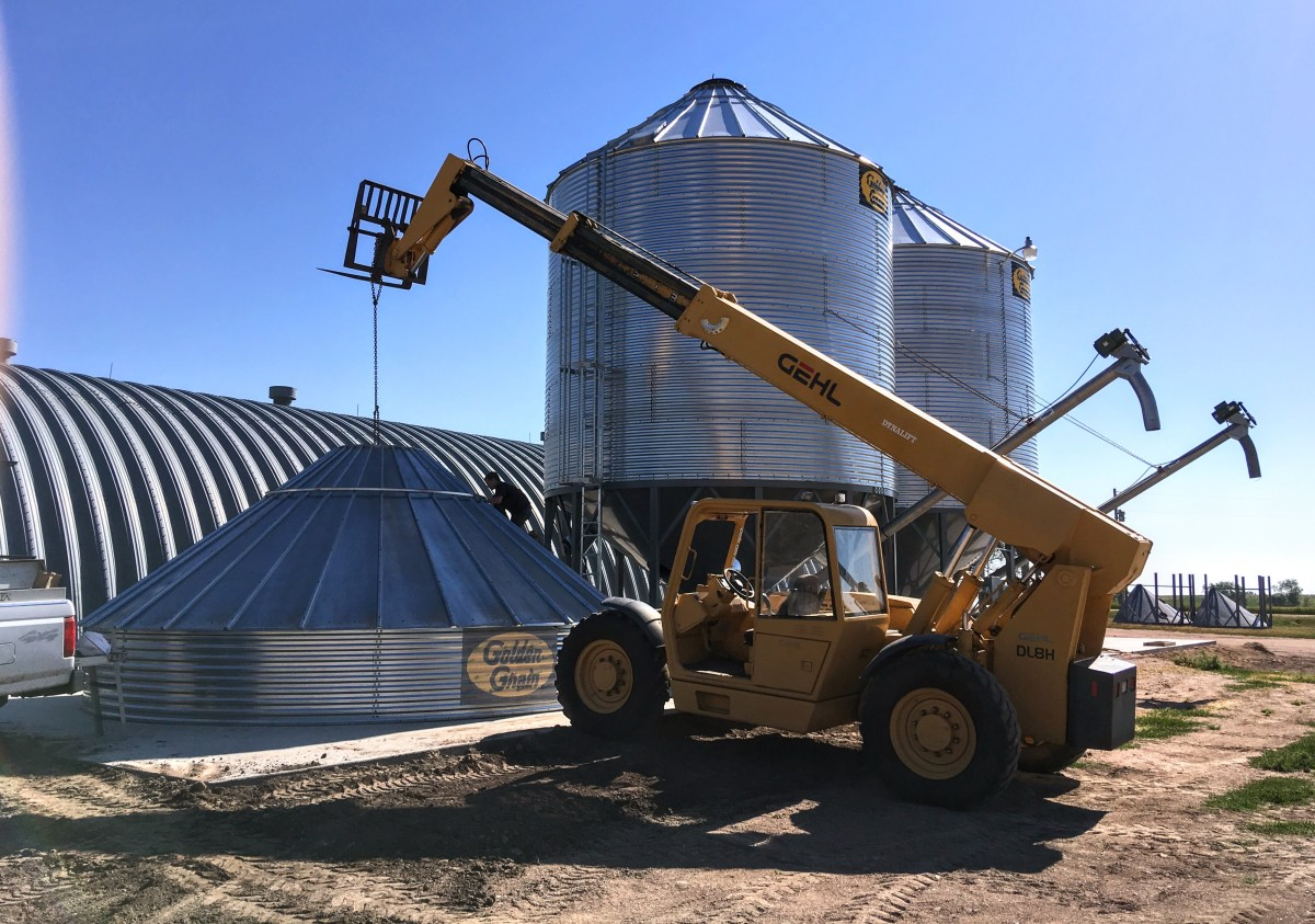 For bin going onto hopper: The single concrete segment on which this bin and hopper is being erected must hold over 100 tons when the bin and hopper are filled with wheat.